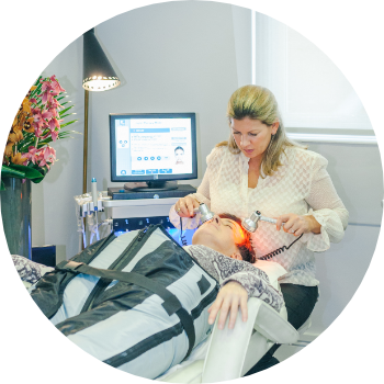 a senior aesthetic practitioner giving a patient a combination of hydrafacial skin treatments