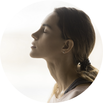 side profile of a woman with her eyes closed