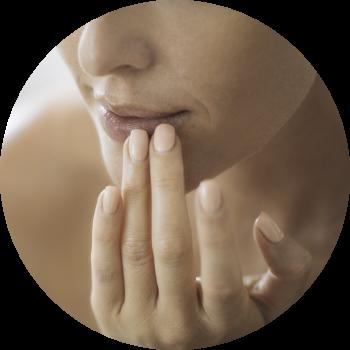 a woman touching her lips