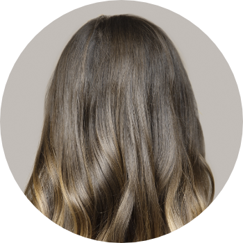 the back of a womans head with long dark hair